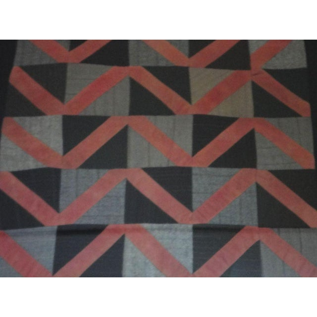 This is a very interesting pattern wool doll quilt. It has the zigzag pattern or streak of lighting within a black and...