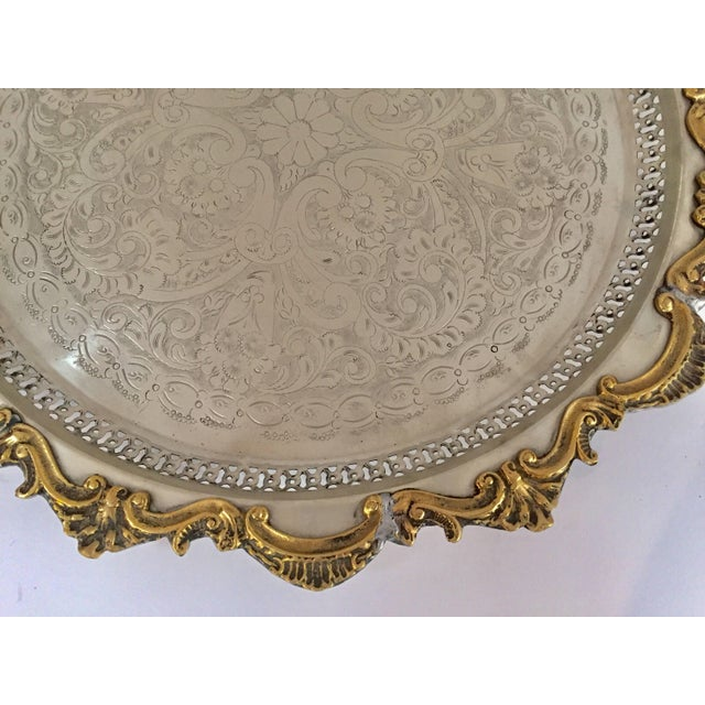 Gorgeous hand chased silver plated large Moroccan round serving tray. Hand-carved amazing Moorish etching motif and silver...