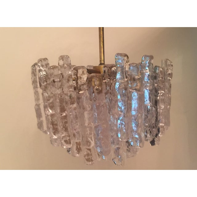 "Vintage Kalmar ""Ice Block"" chandelier with chiseled ice glass elements on a brass frame and rod. 12 textured pieces of..."