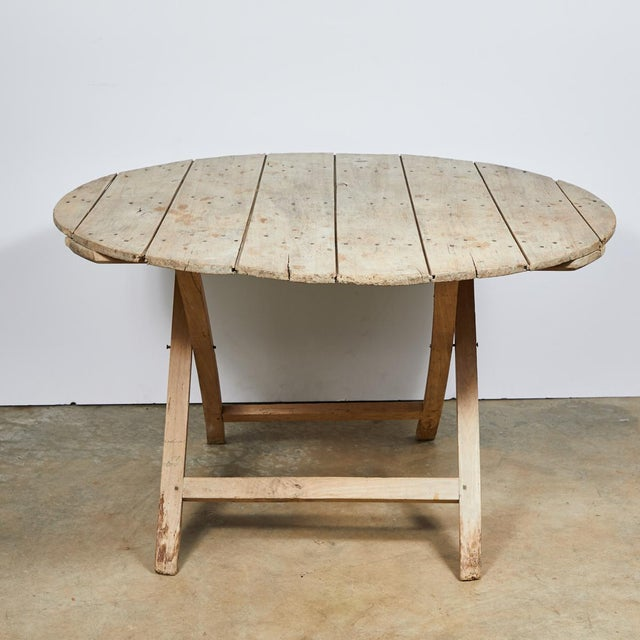 A country folding champagne table.