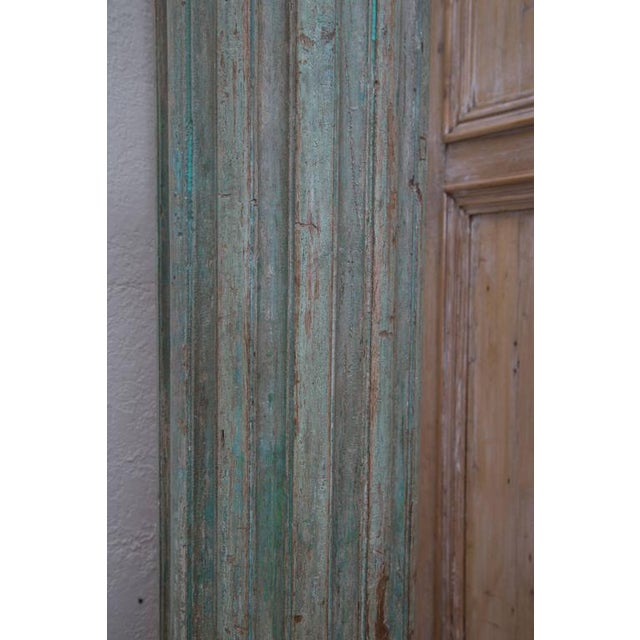 These four large green-painted wooden columns are fluted with capitals and terra cotta bases. These magnificent columns...