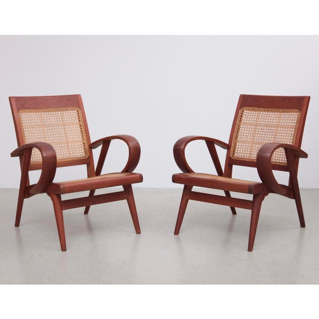 Absolute mint and elegant pair of Danish studio lounge chairs with cane back and seat. Stunning woodworking with only...
