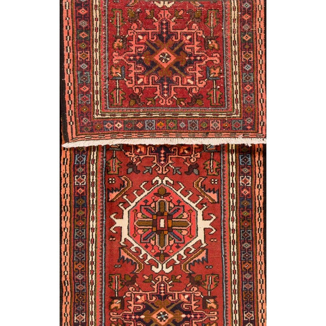 Vintage hand-knotted Persian Heriz rug with a floral and geometric motif. This piece has great detailing and great colors....