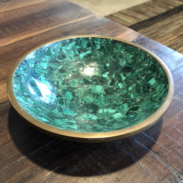 Beautiful chunky and thick bowl made of malachite and brass. This would make a beautiful designer piece anywhere. It's...