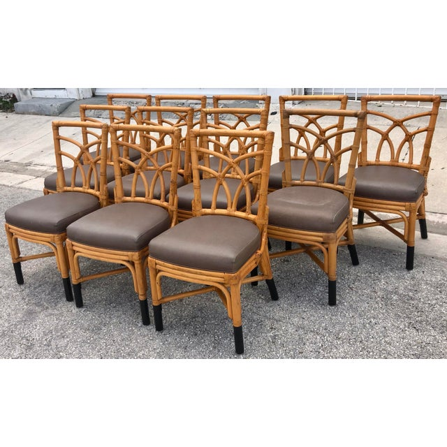 Set of 12 vintage bamboo dining chair with leather ties and black metal-capped legs. The seats are covered in brown...