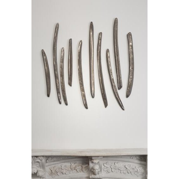 Artist Kathy Erteman creates ceramic vessels as meditations on elegant functionality while disregarding utility. Her work...