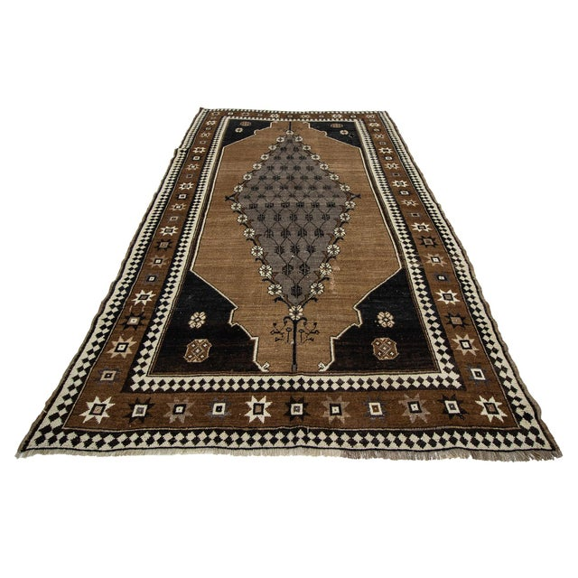 Handknotted vintage wool rug from Kars region of Turkey. Approximately 50-60 years old. In very good condition