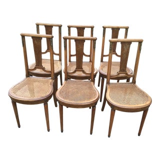 French Louis XVI Bronze/Brass Mounted Inlaid Maple Style Cane Dining Room Chairs - Set of 6 For Sale