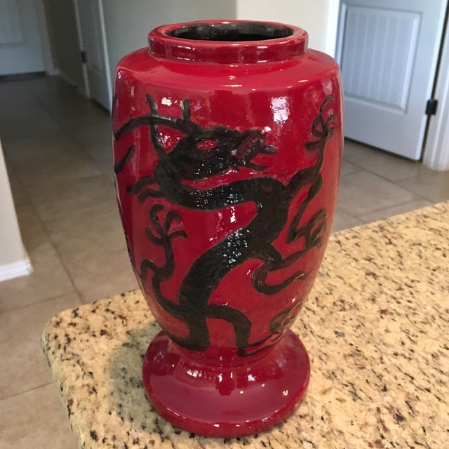 "Stands 9.5"" tall and 5"" in diameter in Crimson red and black. Dated on base 1967 Bil-Mar-Mold. Has one very tiny chip near..."