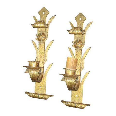 Pair of painted gold wrought iron wall sconces with floral design from Europe.