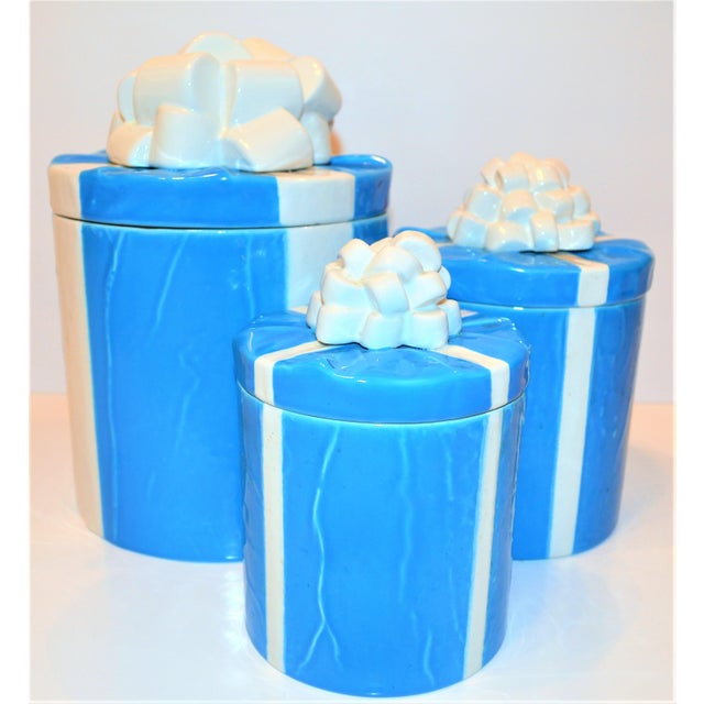 This is a very fun mid-century Italian Trompe l'Oeil art pottery canister set, hand painted in a deep Tiffany. The...