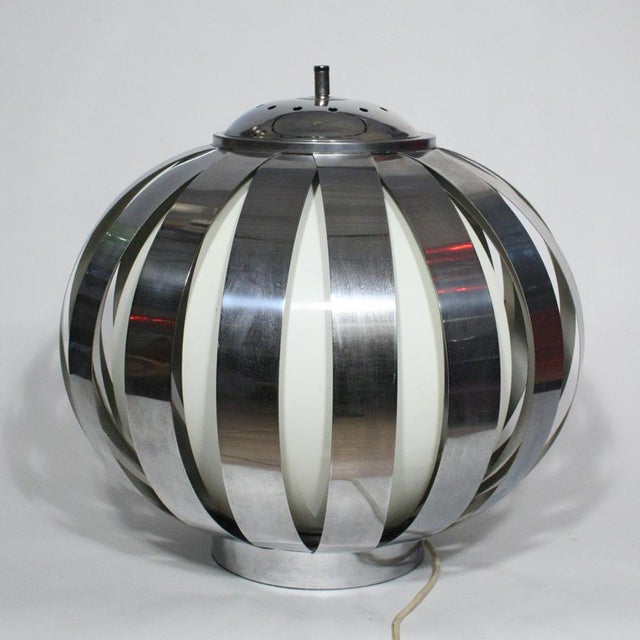 A table lamp, white and chromed steel structure designed by Gae Aulenti 1960's.