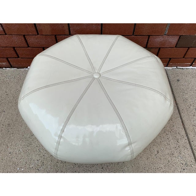 Pair 1970s White Vinyl Ottomans with casters.