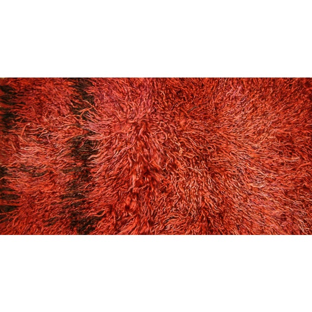 Turkey Circa 1960 A rare long pile Tulu rug from Central Anatolia with a long shaggy weaving and a plain unpatterned field...