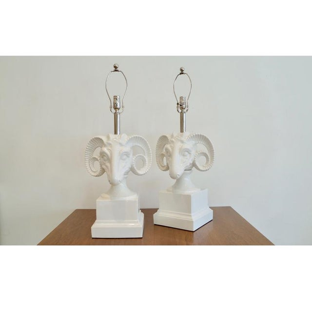 Pair ceramic rams head table lamps.