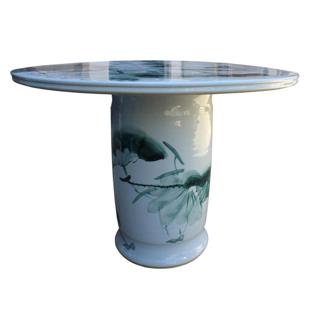 This is a round porcelain white base color table with oriental lotus pond and fish theme. It is a combination of two...