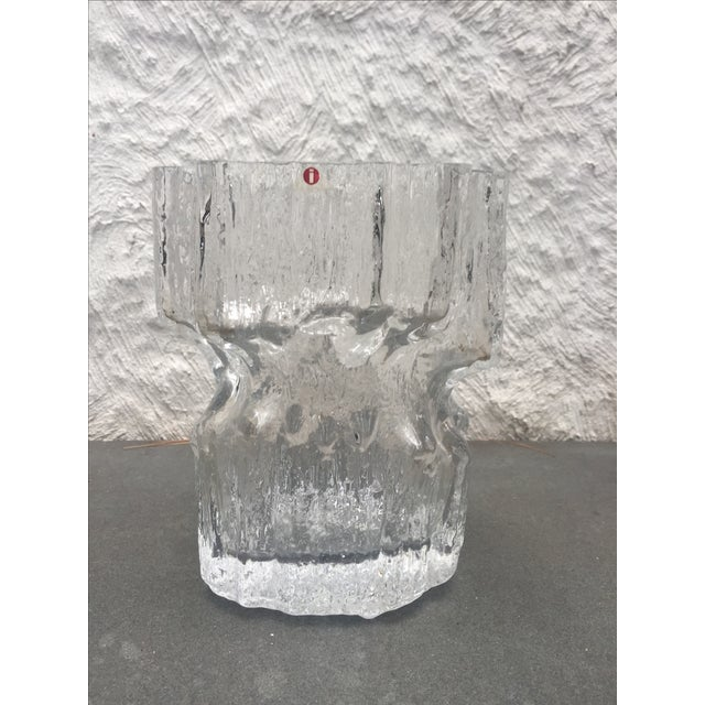 Offered is a glass vase designed by Tapio Wirkkala for iittala. The pattern is Gerania. Signed at the base. The vase is in...
