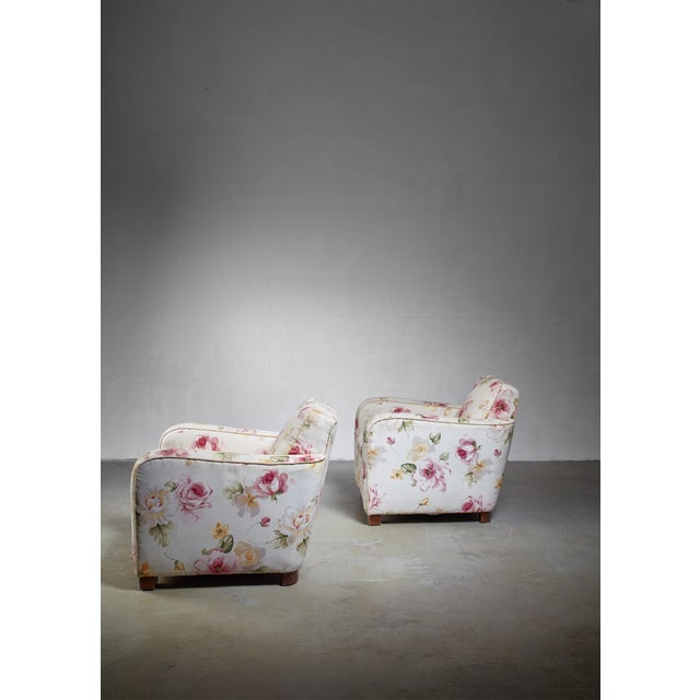 A pair of Swedish 1930s Functionalist easy chairs, in the manner of Björn Trägårdh. The chairs are upholstered with a...