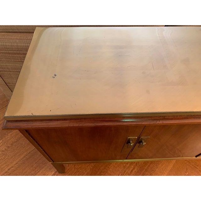 Gorgeous vintage mid-century modern mahogany console with brass top and pulls. In excellent, vintage condition