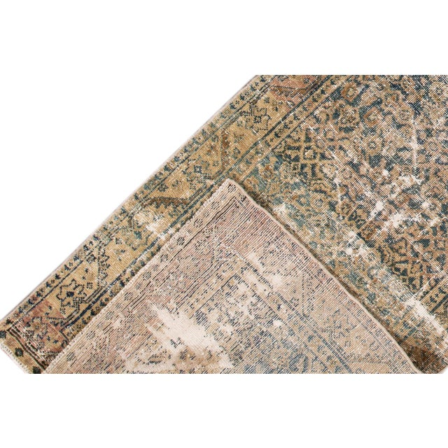 A hand-knotted antique Persian rug with an allover design. This piece has great detailing and colors. It would be the...