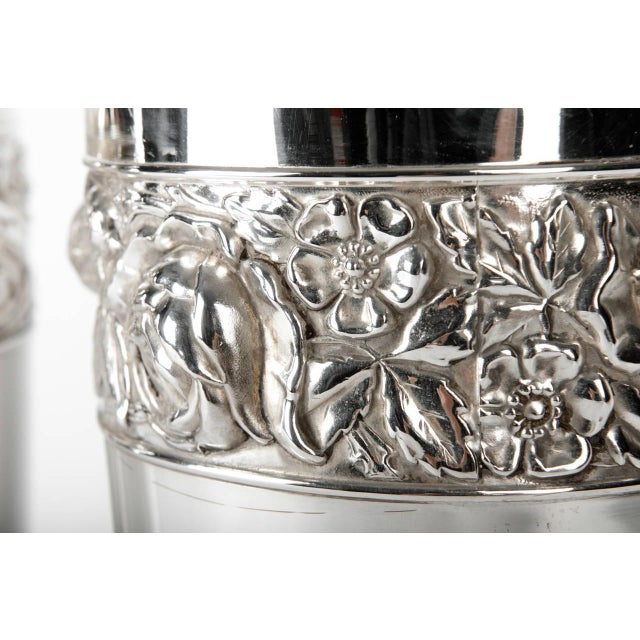 Antique pair of English vase with floral design chased band, circa 1885. Silver plate. Great condition. The vases measure...