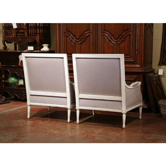 White Pair of 19th Century French Louis XVI Carved Painted Armchairs With Pillows For Sale - Image 8 of 9