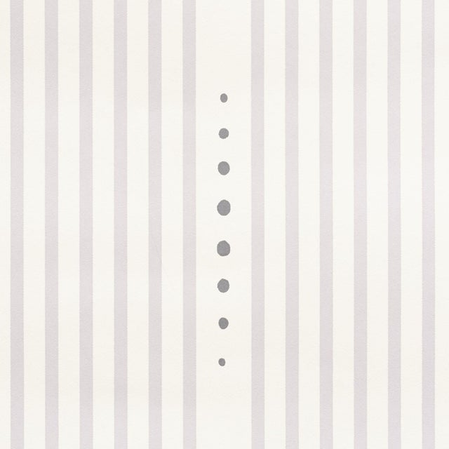 An understated design with a hand-drawn quality, this narrow stripe is enlivened by rows of dainty dots. This lovely...