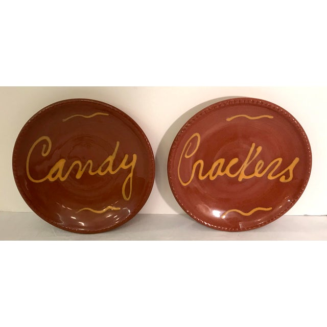 "Beautiful terra cotta ceramic pottery slip design snack plates. Signed on the bottom. One says ""Candy"" and the other says..."