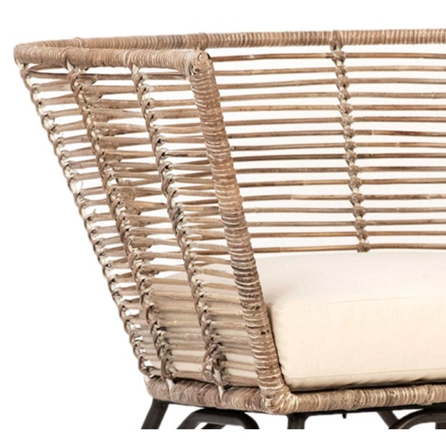 Modern design chair with iron legs and hand woven grey/white wash finish rattan seat. Includes natural linen seat cushion....