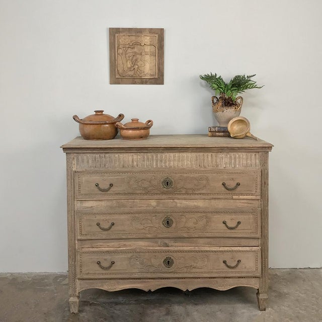 18th Century French Louis XVI Stripped Oak Commode is a classic way to provide convenient storage in style! Hand-crafted...