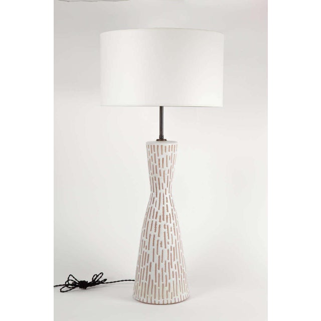 Ceramic table lamp by Raymor. Signed. Italy, circa 1960. Features brown geometric shapes on a white background....