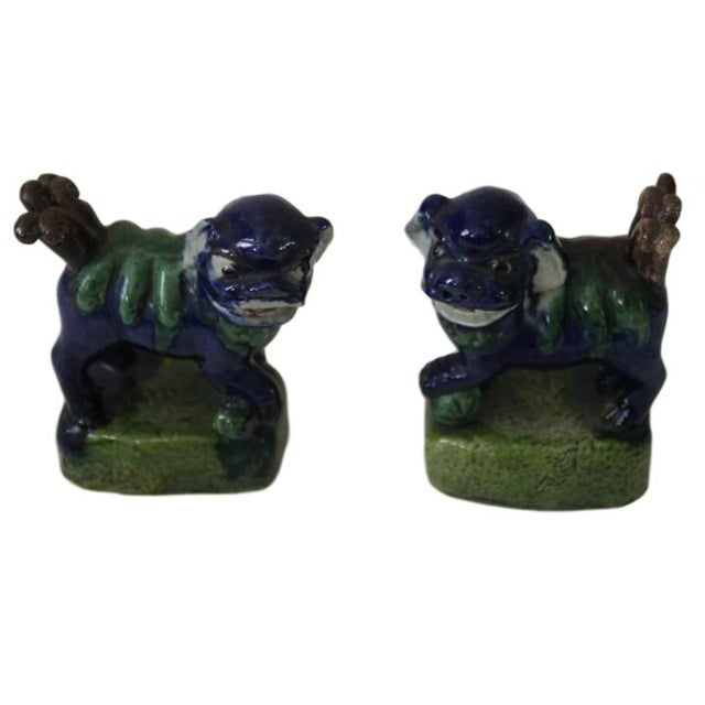 """Antique pair of opposing foo dogs. Overall good condition; Unmarked. 2.5""""W x 1.5""""D x 3.5""""H."""