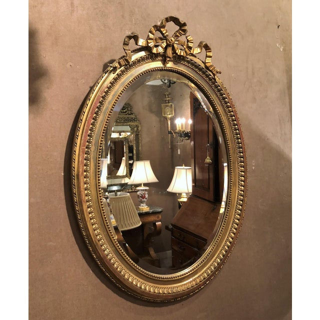 Antique French 19th Century Louis XVI Style Gold Mirror with Beveling.