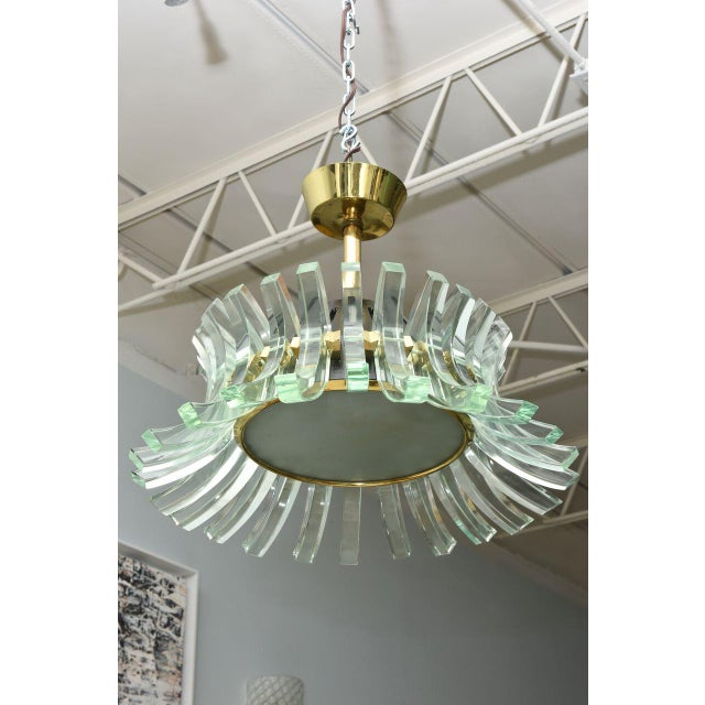 """On a brass rod with glass """"C"""" shaped pieces and a central light source. Provenance: Christies, London. Said to be unique..."""