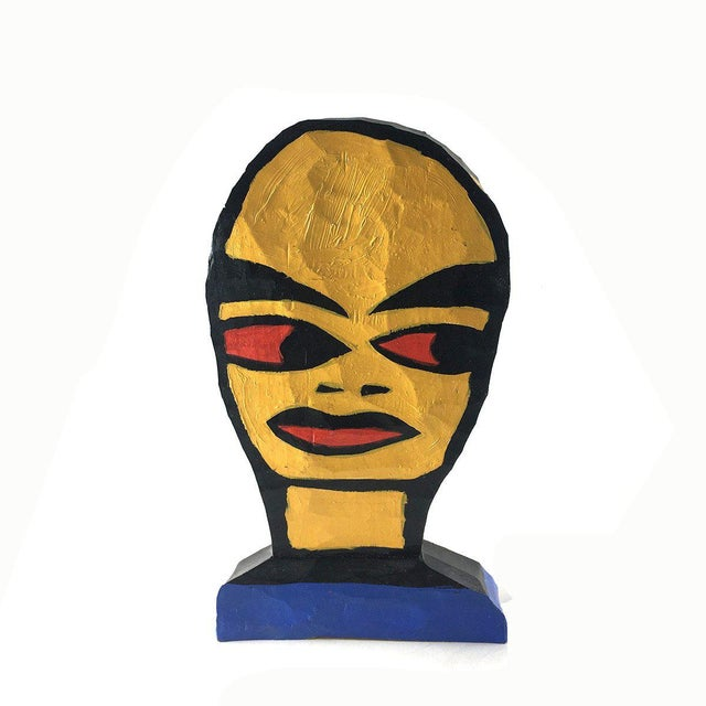 Tom Cramer Contemporary Art Wood Sculpture Carved of white pine. The sculpture is a stylized head, painted in bright...