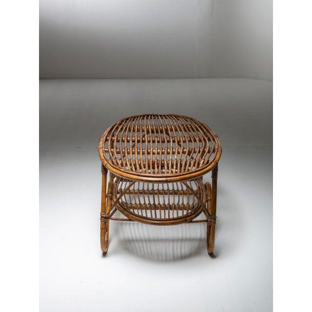 Italian 60s side table with elegant wicker frame.