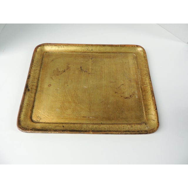Offered is a 1980s vintage Italian gold leaf serving tray. This piece features gold leaf applied onto wood. Stamped: Made...