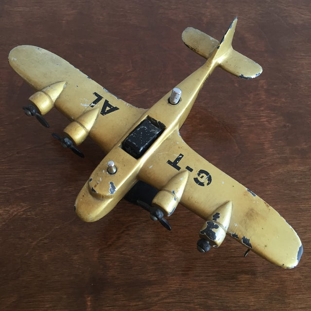 Very nice solid cast iron painted airplane table lighter circa 1920's. Painted in a yellow gold with decals. Hallmark...
