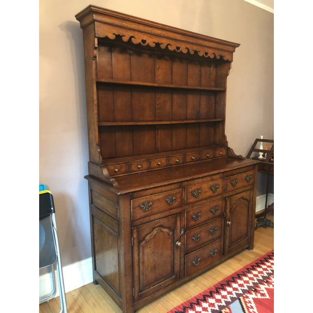 Very old, from 1860. Unmarked, solid wood china cabinet with original brass hardware. In great condition. No known chips...