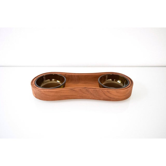• Danish modern teak and glass condiment tray designed by Jens Quistgaard for Dansk. • Classic mid century design with...