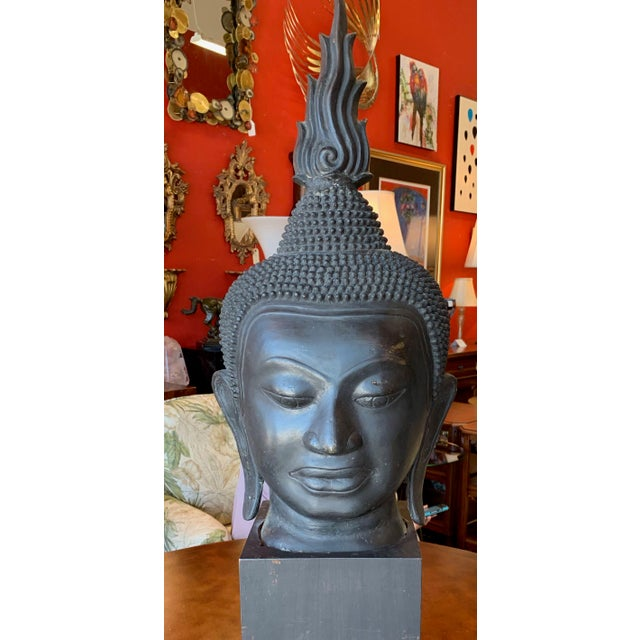 The head is Thai in the Nan La or Cheng Mai style. The wide face and nose, contour lines around the hair and lips, and...