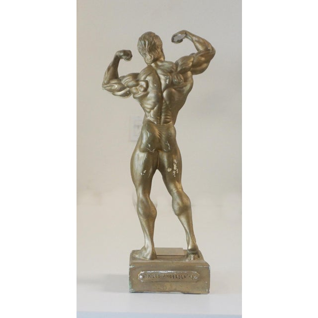 Niels Andersen Muscle Man Trophy 1995 Made of a durable poly-resin coated with gold finish. Plaque reads Americas Natural...