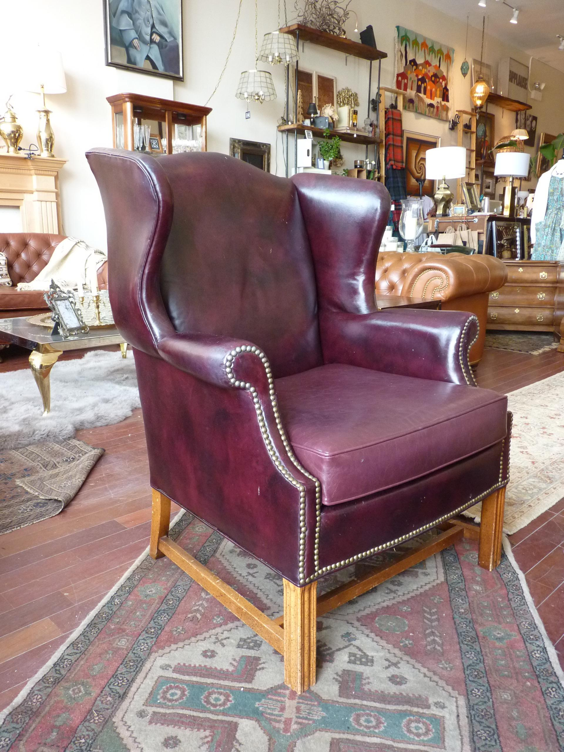 Merveilleux This Dark Red Leather Wingback Chair Defines Sophistication And Style. The