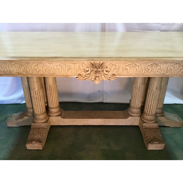 19th C. Carved Mahogany Table with classic lines shows beautiful intricate carvings of Bacchus on all four sides. The...