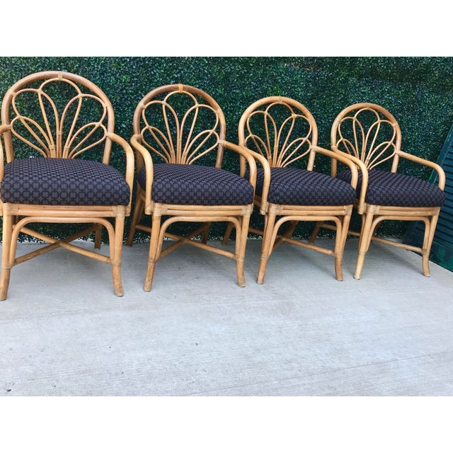 Stunning Vintage Rattan Chairs, Set of Four. Beautiful bent bamboo arched back with black upholstered cushions. Original...