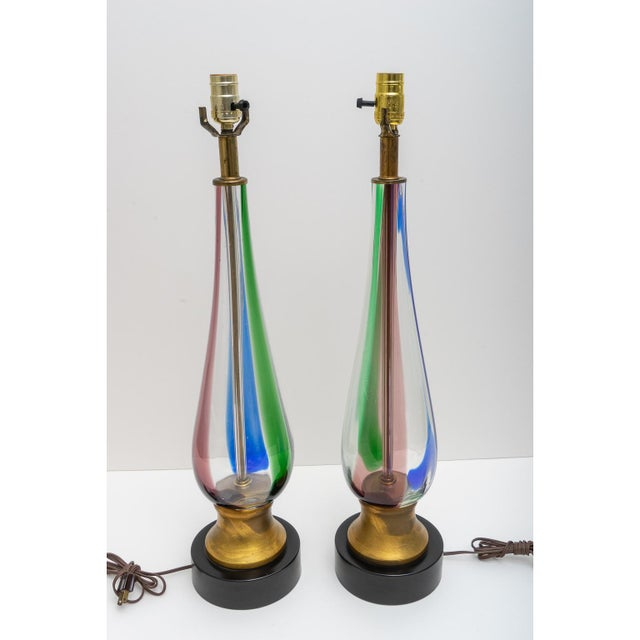 This stylish pair of Murano glass table lamps date to the 1970s and were acquired from a Palm Beach estate.
