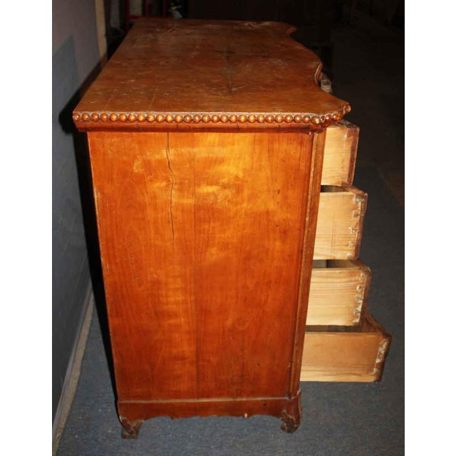 This dresser has a serpentine front, and the top of the dresser has beading along the edge. The top drawer needs work,...