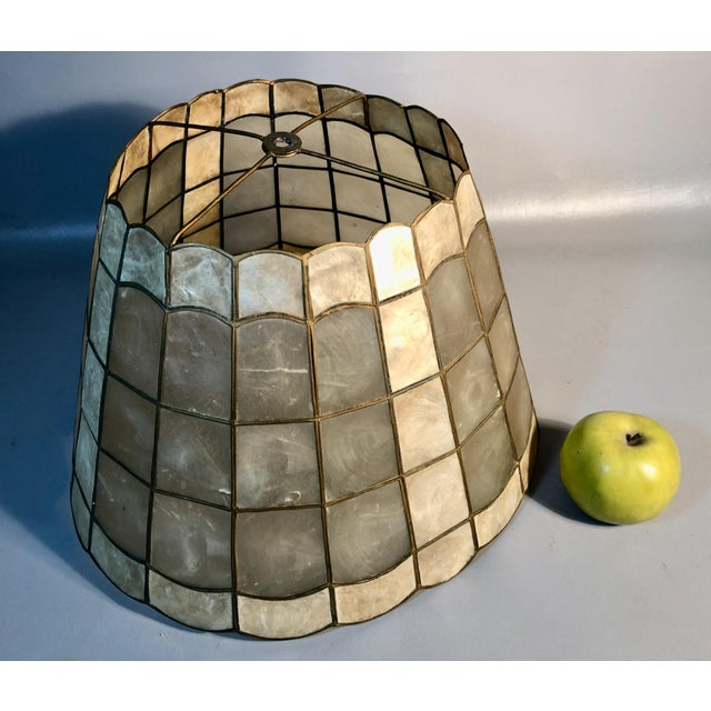 Add a warm glow to any room with this 5 tier Capiz shell lamp shade with brass frame. Scalloped top and base with clear...