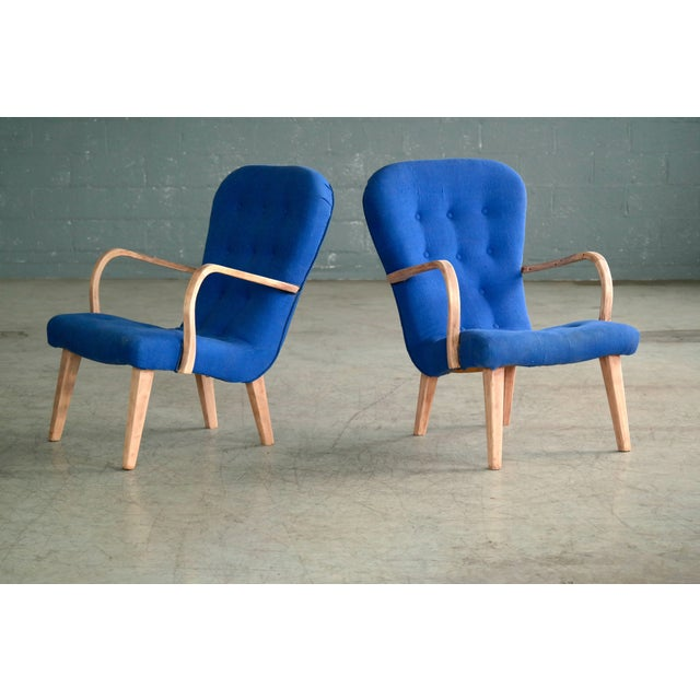 Pair of charming lounge chairs made in Denmark from beech wood and covered with wool. This design is seen from time to...
