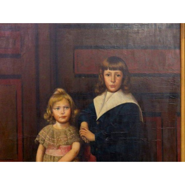 A palatial oil on canvas of a portrait of siblings signed J. Peellaert. A finely detailed oil on canvas of a boy and his...